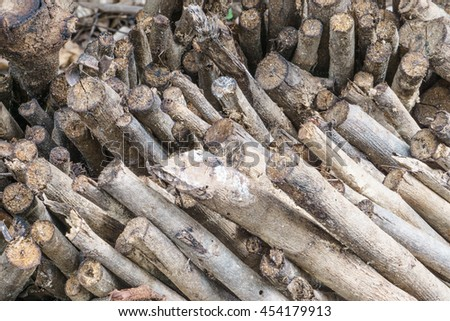 Woodpile cutting timber for the forestry and timber industry ,many cut timber, wood, firewood background - chopped firewood on a stack - stock photo