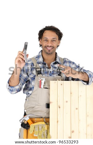 woodworker holding a cell phone - stock photo