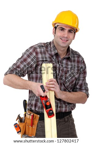 woodworker working with a rasp - stock photo