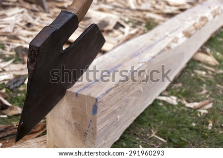woodworkers Axe and handmade wooden scantling - stock photo