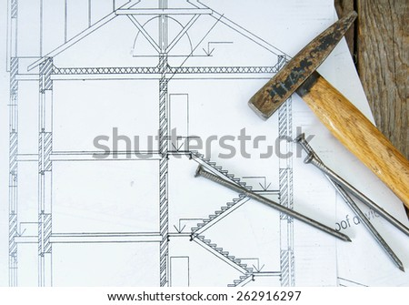 Woodworking. Joiner's works. Drawings for building and working tools on wooden background. - stock photo