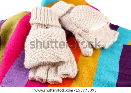 Wool fingerless gloves and multicolor scarf, isolated on white - stock photo