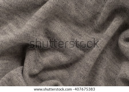 Wool gray knitted fabric. Texture - stock photo