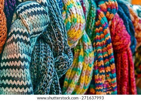 Wool scarves of various colors, exposed for sale. - stock photo