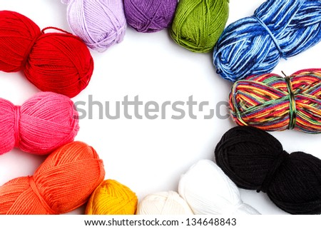 Wool yarn arranged in circle with space for your text - stock photo