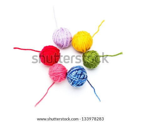 Wool yarn balls arranged in circle - stock photo