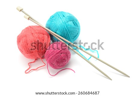 Woolen balls and knitting needles isolated on white - stock photo