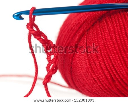 Woolen thread with crochet example over white background - stock photo