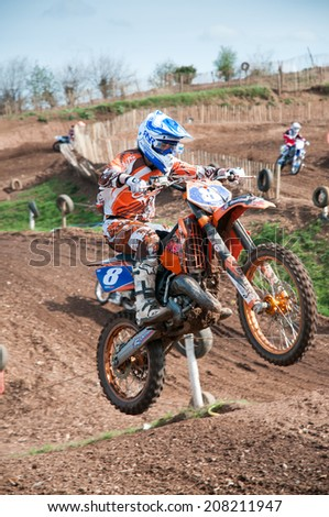 Worcester,UK-APRIL 05 2009 :A competitor taking part in a Motocross race.Motocross is an extreme sport with venues in many countries around the world - stock photo