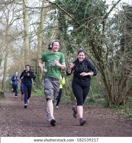 WORCESTER,UK - MARCH 15 2014 : Competitors take part in a Park Run on March 15 2014 in Worcester,UK. Park Run races are held every Saturday in the UK and the rest of the World. - stock photo