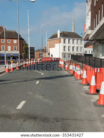 WORCESTER , UK - OCTOBER 11 2015 : Traffic cones in a city street warn drivers of road works ahead - stock photo