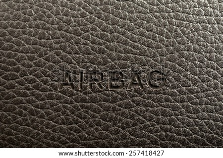 "Word ""Airbag"" written on car's dashboard. Interior detail. - stock photo"