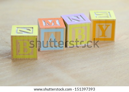 Word baby lined with children's wooden blocks for elementary education alphabet - stock photo