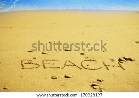 """word """"beach"""" written on the sand - stock photo"""