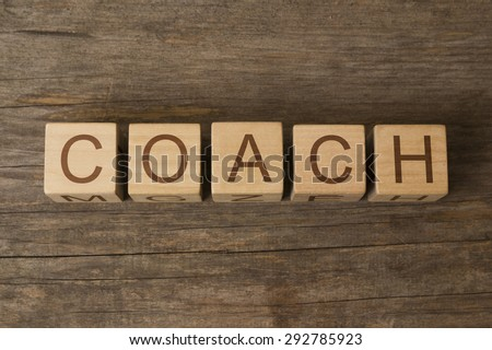 word coach on wooden cubes - stock photo