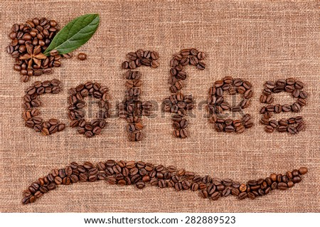 Word coffee made from coffee beans on burlap - stock photo