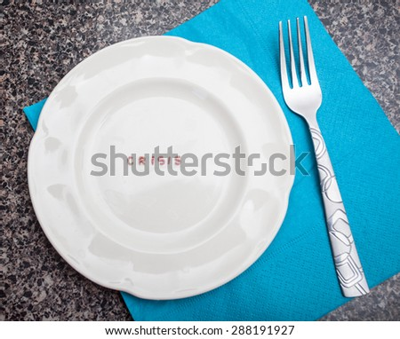 Word Crisis written with pasta on an empty colorful dish - stock photo