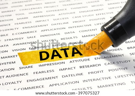 Word data highlighted with marker on paper of other related words. For direction of business strategy success concept - stock photo