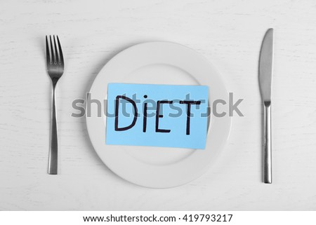 Word Diet with empty plate on white table - stock photo