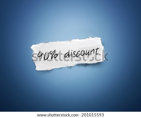 Word - 90% discount - written on a torn rectangular scrap of white paper on a blue background with a vignette - stock photo