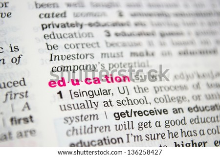 Word education from the old dictionary, a close up - stock photo