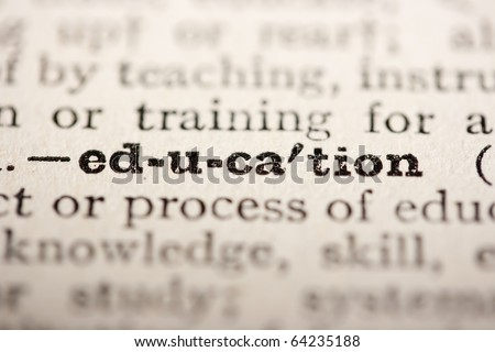 Word education from the old dictionary, a close up. - stock photo