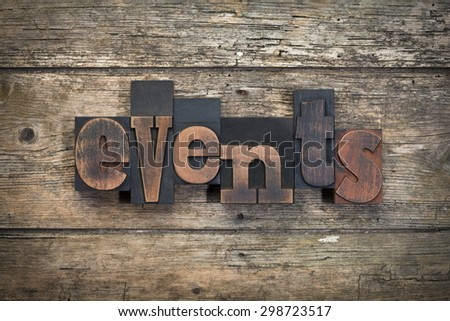 """word """"events"""" written with vintage letterpress printing blocks on rustic wood background - stock photo"""