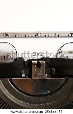 Word FAQ written on an old typewriter - stock photo