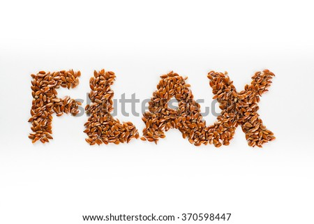 Word flax piled of flax seed on white background. - stock photo
