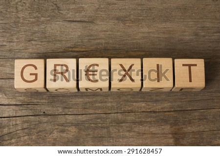word GREXIT on a wooden cubes - stock photo