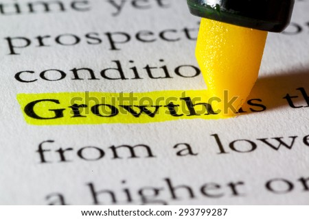 Word growth highlighted with a yellow marker - stock photo