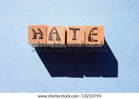 word hate in wooden blocks - stock photo