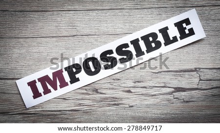 Word impossible. Motivation philosophy concept.Concepts of problem solving, overcoming challenges and success. - stock photo