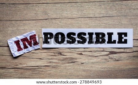 Word impossible transformed into possible. Motivation philosophy concept.Concepts of problem solving, overcoming challenges and success. - stock photo