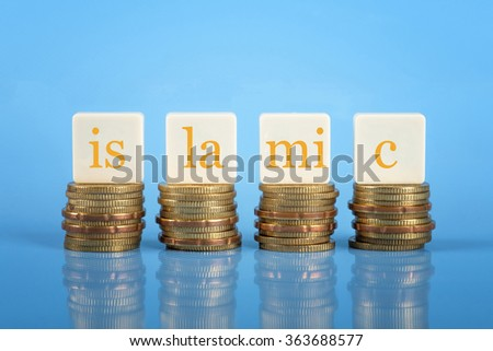 Word ISLAMIC on stacked coins, Islamic finance conceptual. - stock photo