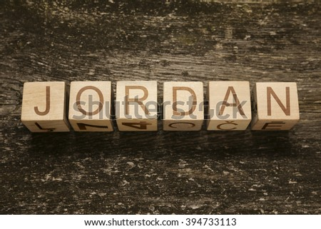 Word JORDAN on a wooden background - stock photo