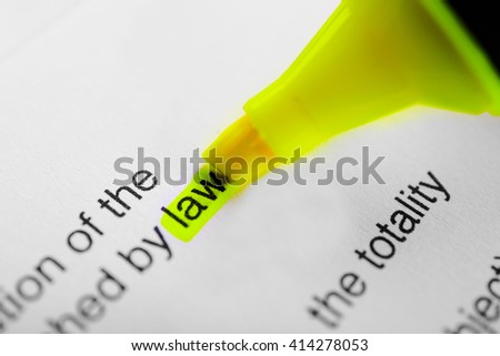 Word law highlighted with a yellow marker - stock photo