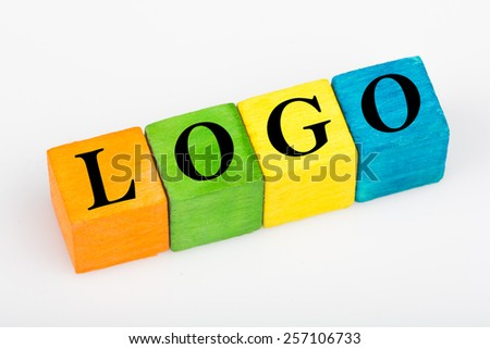 word logo on colorful wooden cubes isolated on white background - stock photo