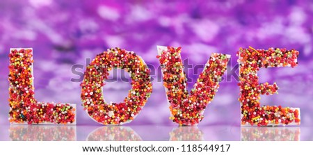 Word Love on purple background - stock photo