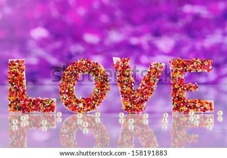"Word ""Love"" on purple background - stock photo"