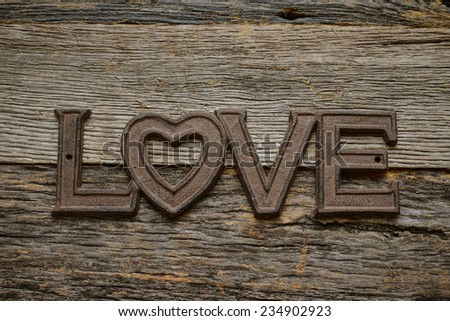 Word Love on rustic wood background - stock photo