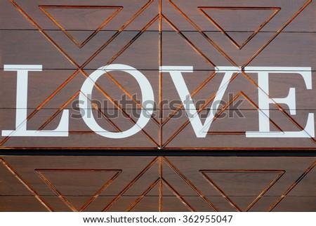 Word LOVE on vintage wood background - stock photo