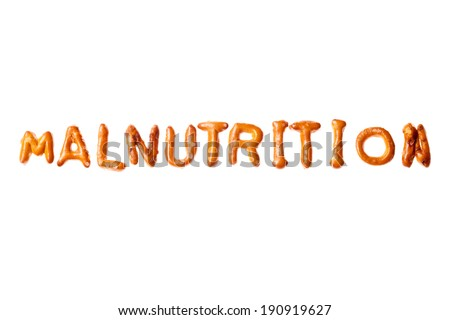 Word MALNUTRITION written, laid-out, with crispy alphabet pretzels isolated on white background - stock photo