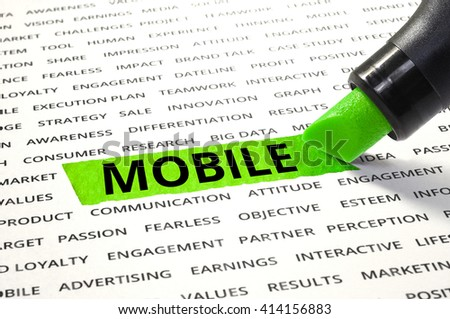 Word MOBILE highlighted with marker on paper of other related words. For direction of business marketing concept - stock photo
