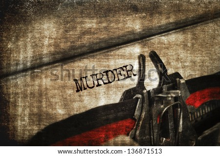 word murder written with an old typewriter - stock photo