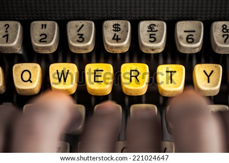 word qwerty on the old typewriter - stock photo