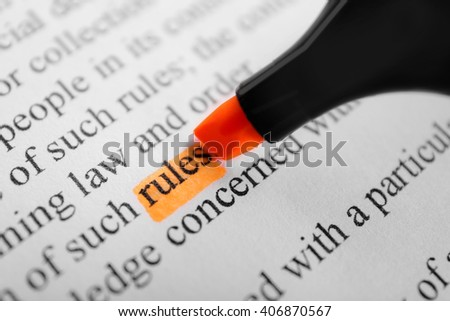 Word Rules highlighted with an orange marker - stock photo