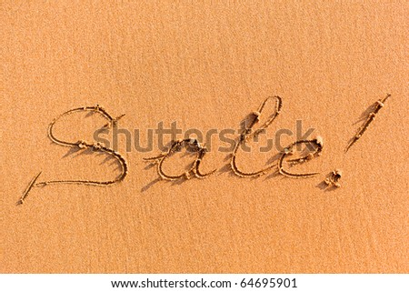 Word Sale on clean sand - stock photo