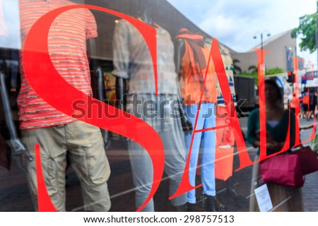 word sale print on shopfront window - stock photo