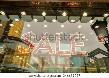 word sale spell with bubbles on shopfront window - stock photo